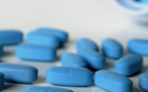 blue pills spread on a white counter