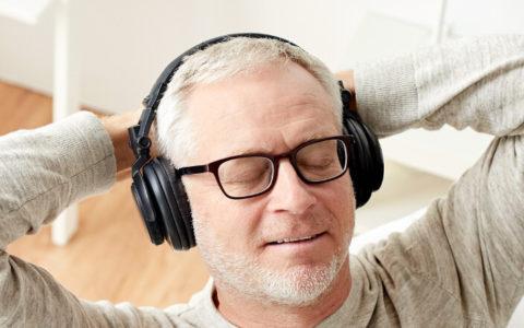 man listening to music raising his vibration for better health