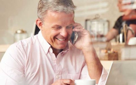 man on cell phone low sperm count more common today